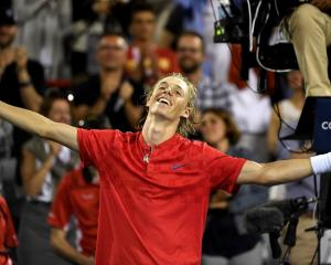 Denis Shapovalov celebrates his victory over Rafael Nadal. Photo: Eric Bolte-USA TODAY Sports