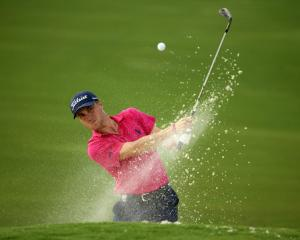 Justin Thomas plays from a bunker during the final round. Photo: Rob Schumacher-USA TODAY Sports