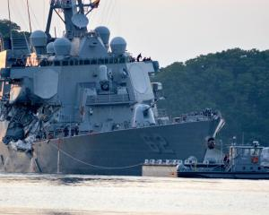 USS Fitzgerald returns to Fleet Activities Yokosuka in Japan following the collision. Photo...
