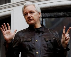 WikiLeaks founder Julian Assange addresses media from the balcony of the Ecuadorian Embassy in...