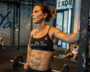 Crossfit competitor Jamie Greene takes a break during a workout at her gym in Abu Dhabi. PHOTO:...
