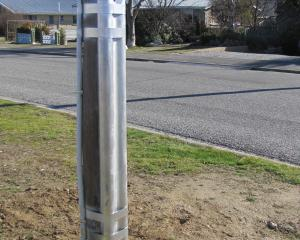 A pole in Alexandra that has been nailed by a crew from Aurora Energy. The pole is beside the one...