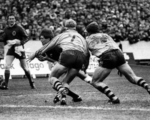 All Black halfback David Kirk scores a try past Wallaby openside flanker Jeff Miller (left) and...