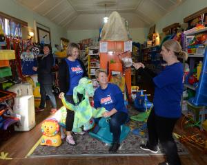 Swinging into action at the Caversham Toy Library yesterday are (from left) library secretary Mel...