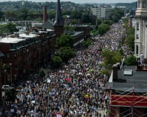 A large crowd of people march towards the Boston Commons to protest the Boston Free Speech Rally....