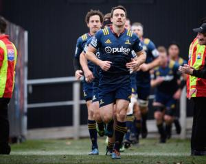 Ben Smith of the Highlanders leads his team onto the field. Photo: Getty