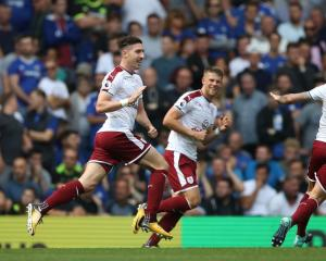 Burnley's Stephen Ward (left) celebrates with team mates after scoring his side's second goal...