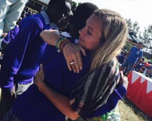 So They Can founder Cassandra Treadwell hugs a pupil at the Aberdare Ranges Primary School in...