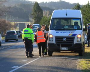 Police attend the scene of a crash on State Highway 1 near Palmerston. Photo: Hamish MacLean