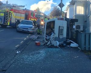 A van ended up on its side after a crash in Stuart St, Dunedin. Photo: Stephen Jaquiery