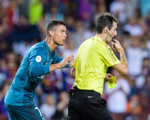 Real Madrid's Cristiano Ronaldo reacts to being red carded in yesterday's El Classico. Photo:...
