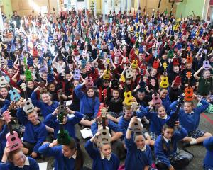 A rare moment of silence at the Dunedin Ukulele Kid's Jam as children give the ukulele salute....