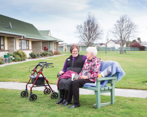 Nola Howden (left) and Thelma Eaton at Resthaven Village enjoying the sunshine on a winter's day.