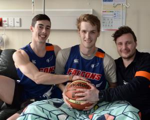 Andy Bay Falcons players Fraser Beck (23) and Alex Yarnall (21) and coach Greg Brockbank at the...