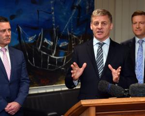 Prime Minister Bill English (centre) announces details of the Dunedin Hospital rebuild last...