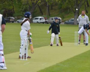 Jackson Milne, of the Kaikorai Sonics, bowls to Taieri Sparkles batsmen Grace Cotter during a...