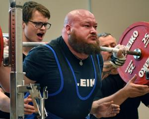 Northland power lifter Joseph Whitaker grunts a massive 375kg up from a squat to break the New...