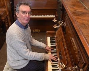 Musical director Mark Dorrell tests a piano from Alexander Pianos for the upcoming production of...