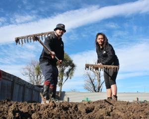 Telford students Louis Pene and Monika Dean rake the Balclutha Community Garden as part of a...