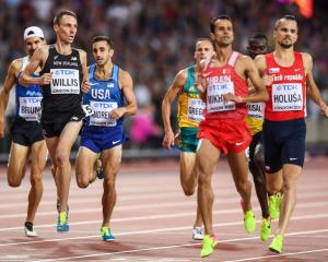 Nick Willis crosses the line to comfortably qualify for the 1500m semifinals at the IAAF world...