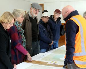 Examining updated road safety plans at the peninsula connection open day at Macandrew Bay...