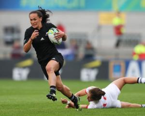 Portia Woodman on the way to scoring one of her four tries for the Black Ferns. Photo: Getty Images