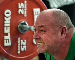 Central Districts powerlifter Ian Dennis lifts a squat of 250kg at the national powerlifting...