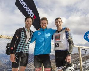Peak to Peak winner Hamish Fleming is flanked by second-placed Eryn Cutler (left) and third...