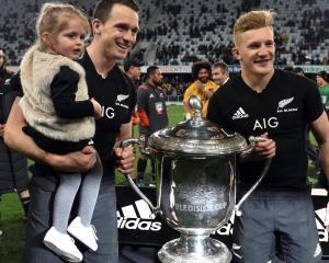 Family fun... Ben Smith and his daughter Annabelle with the Bledisloe Cup and All Black Damian...