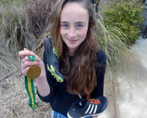 Wanaka runner Sammy Burke (18) with the gold medal she won at the Australian secondary schools...