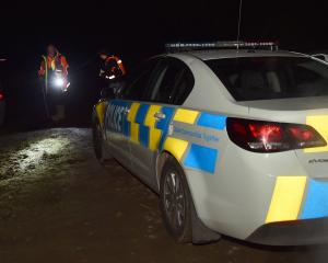 Search and rescue volunteers were last night searching for the occupants of this car. Photo:...