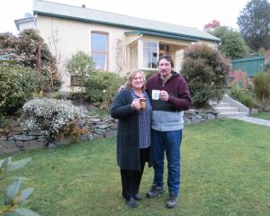 Linda and Casper Barnard raise a mug to their new house in Mornington. PHOTO: JOSHUA RIDDIFORD