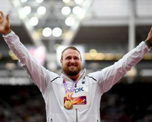 Tom Walsh on the medal podium. Photo: Getty Images