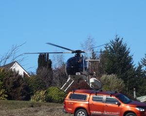 A helicopter carrying members of the Wanaka LandSAR team take off from the Search and Rescue...
