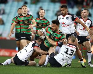 Zane Musgrove of the Rabbitohs is tackled by New Zealand Warriors at ANZ Stadium Sydney Photo...