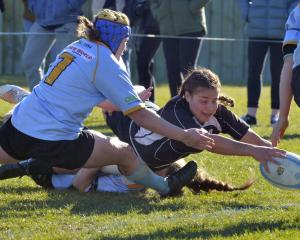 Pirates first five-eighth Celine Timoko reaches out to score a try during the women's club final...