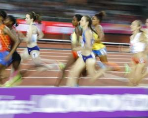 Athletes compete during the World Athletics Championships women's 1500 metres final at London...
