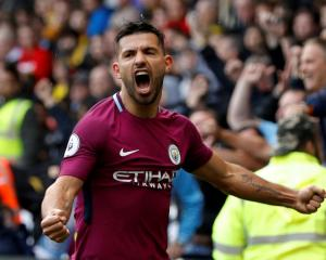 Manchester City's Sergio Aguero celebrates completing his hat-trick. Photo Reuters