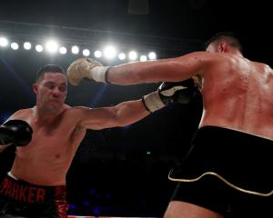 Joseph Parker (L) throws a left at Hughie Fury during their bout. Photo Reuters