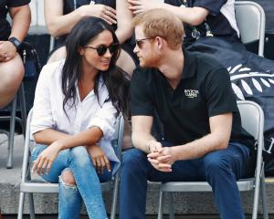 Prince Harry and Meghan Markle turned out to watch the wheelchair tennis at the Invictus Games in...