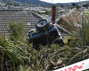An SUV hurtled into the side of a Stuart St house in the early hours this morning. Photo: Gregor...