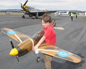 Flynn Millar (9), of Alexandra, holds a model Curtiss P-40N Kittyhawk at the Wings 'n' Wheels...