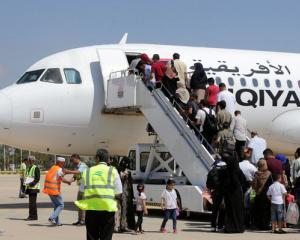 Passengers board a flight at Benina airport east of Benghazi in Libya. Photo: Reuters