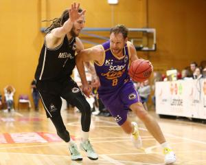 The Sydney Kings' Brad Newley drives to the hoop on Melbourne United's Craig Moller at the NBL's...