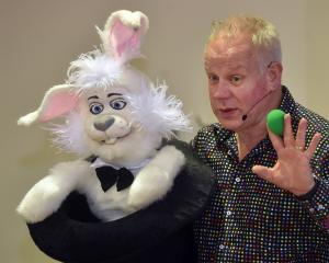 Ringo the Rabbit and magician Elgregoe (Greg Britt) teach Sacred Heart School pupils how to make...