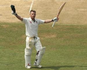 Australian batsman David Warner celebrates his century against Bangladesh. Photo: Getty Images