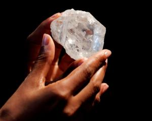 "A model displays the 1109 carat ""Lesedi La Rona"" diamond. Photo: Reuters"