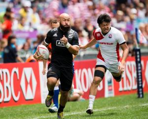 Retiring New Zealand sevens player DJ Forbes makes a break against Japan in Hong Kong earlier...