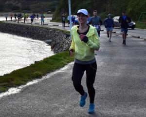 Jamie Marra running in yesterday's Dunedin marathon for Unicef's Children in Conflict. Photo:...