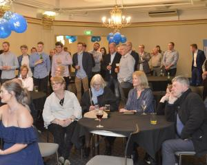 Dunedin National supporters keep an eye on the results as they come in at Wains Hotel. Photo: Gerard O'Brien